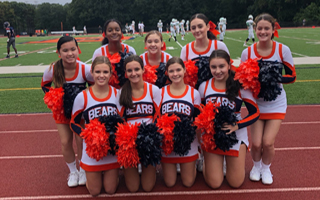 Varsity Cheerleaders at the Home Opener vs. Irvington