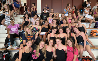 Varsity Girls Swimming & Diving After a Meet on the Road