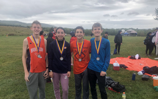 Varsity Cross Country's Four Top Ten Finishers at the Warwick Mania Relay